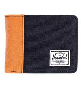 Cartera Herschel Edward de color negro. Esta billetera presenta uno de los modelos más icónicos de la marca. Descubre más carteras de hombre en nuestro catálogo